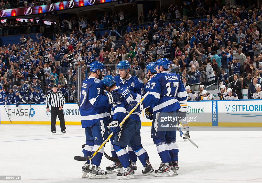 Martin St. Louis #26 of the Tampa Bay Lightning celebrates his goal with teammates during the third period of tonight's game against the Buffalo Sabres at the Tampa Bay Times Forum on October 26, 2013 in Tampa, Florida.