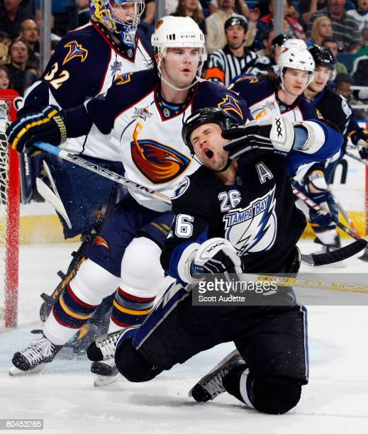 Martin St. Louis of the Tampa Bay Lightning reacts after being high-sticked by Steve McCarthy of the Atlanta Thrashers during the first period at St....