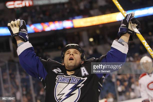Martin St Louis of the Tampa Bay Lightning scores a first period goal against the Montreal Canadiens at the St Pete Times Forum on January 27 2010 in...