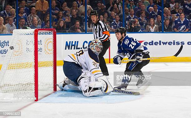 Martin St. Louis of the Tampa Bay Lightning scores a goal against Ryan Miller of the Buffalo Sabres during the third period at the St. Pete Times...