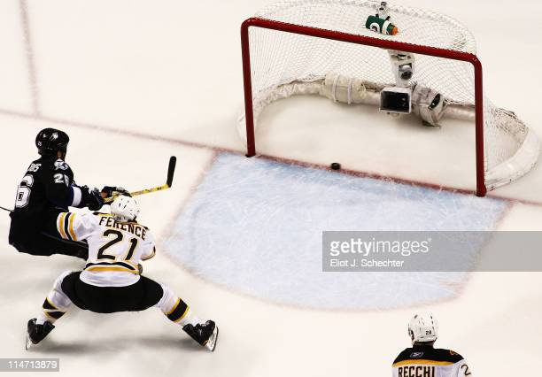 Martin St Louis of the Tampa Bay Lightning scores a second period goal past Andrew Ference and Mark Recchi of the Boston Bruins in Game Six of the...