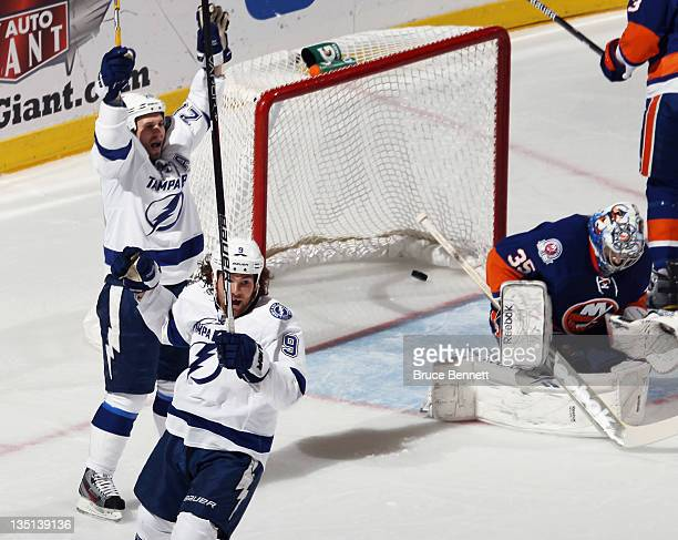 Martin St Louis of the Tampa Bay Lightning scores his 800th career point at 655 of the first period against Al Montoya of the New York Islanders at...