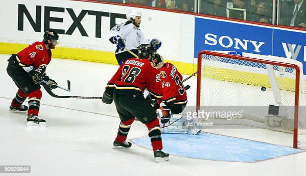 Martin St. Louis of the Tampa Bay Lightning scores the game winning goal past goaltender Miikka Kiprusoff of the Calgary Flames during the second...