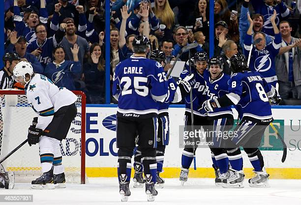 Martin St. Louis of the Tampa Bay Lightning, second from right, celebrates his third goal of the period with teammates including Mark Barberio, J.T....