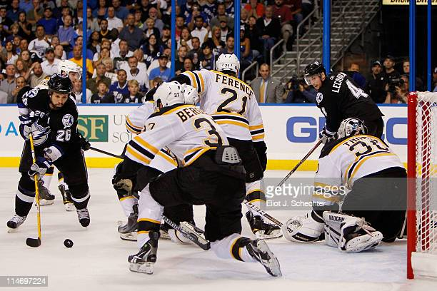 Martin St Louis of the Tampa Bay Lightning shoots a second period goal past Patrice Bergeron Johnny Boychuk Andrew Ference and Tim Thomas of the...