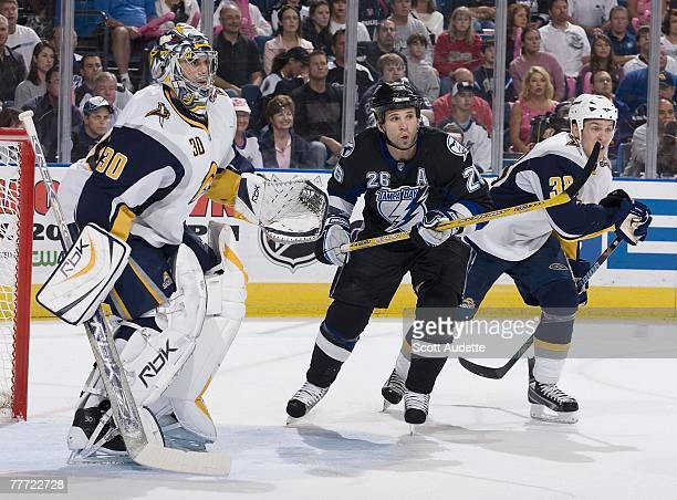 Martin St Louis of the Tampa Bay Lightning tries to get in front goaltender Ryan Miller of the Buffalo Sabres as Nathan Paetsch of the Buffalo Sabres...