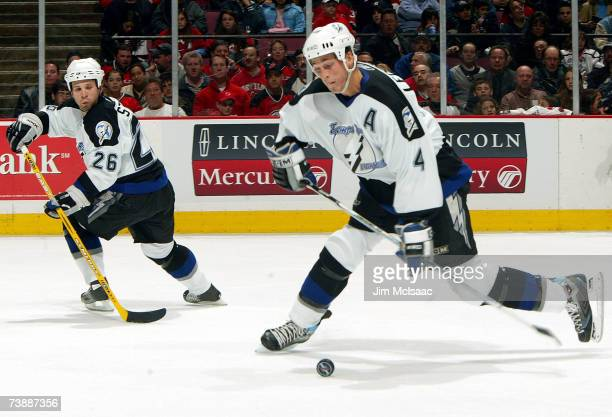Martin St Louis of the Tampa Bay Lightning watches as teammate Vincent Lecavalier takes a shot in the second period of Game 2 of the 2007 Eastern...