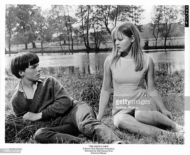 Martin Stephens and Ingrid Brett play school sweethearts with a dark secret in a scene from the film 'The Devil's Own' 1966