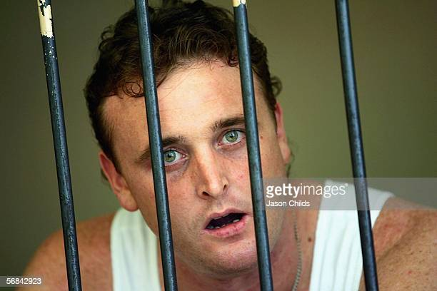 Martin Stephens looks on from his holding cell after his sentencing at Denpasar Court February 14 2006 in Denpasar on the Indonesian resort island of...