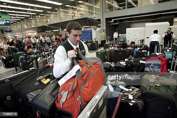 Martin Stoychev unloads checked baggage at a busy Transportation Security Administration Xray station at O'Hare International Airport December 22...