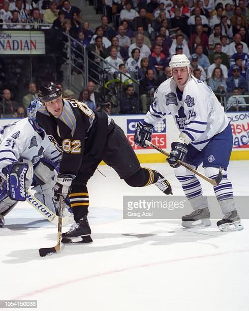 Martin Straka of the Pittsburgh Penguins skates against Bryan Berard and Curtis Joseph of the Toronto Maple Leafs during the 1999 Quarter Finals of...