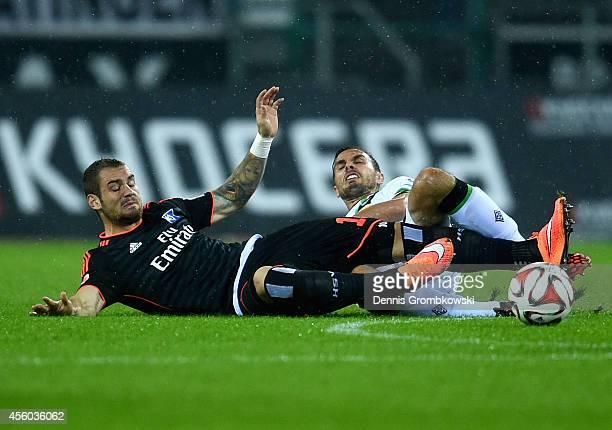 Martin Stranzl of Borussia Moenchengladbach challenges PierreMichel Lasogga of Hamburger SV during the Bundesliga match between Borussia...