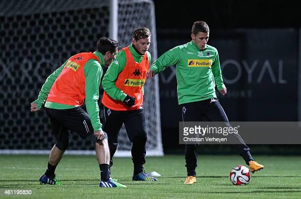 Martin Stranzl of Borussia Moenchengladbach Marlon Ritter of Borussia Moenchengladbach and Thorgan Hazard of Borussia Moenchengladbach battle for the...