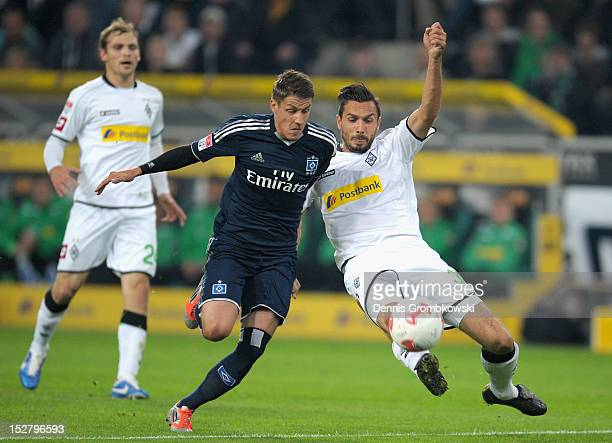 Martin Stranzl of Moenchengladbach challenges Ivo Ilicevic of Hamburg during the Bundesliga match between Borussia Moenchengladbach and Hamburger SV...