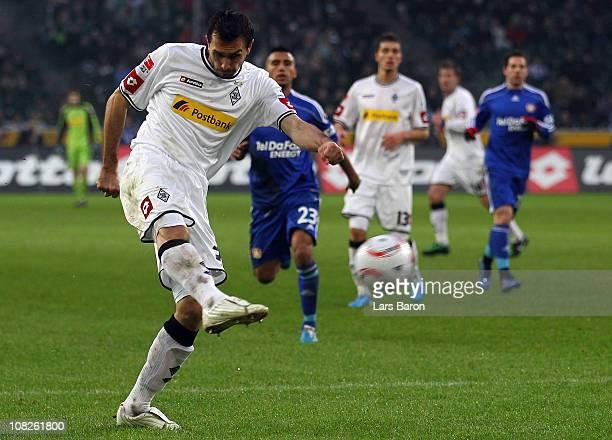 Martin Stranzl of Moenchengladbach scores his teams first goal during the Bundesliga match between Borussia Moenchengladbach and Bayer Leverkusen at...