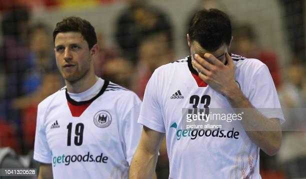 Martin Strobel and Dominik Klein of Germany react after the men's Handball World Championships quarter-final match Spain vs Germany in Saragossa,...