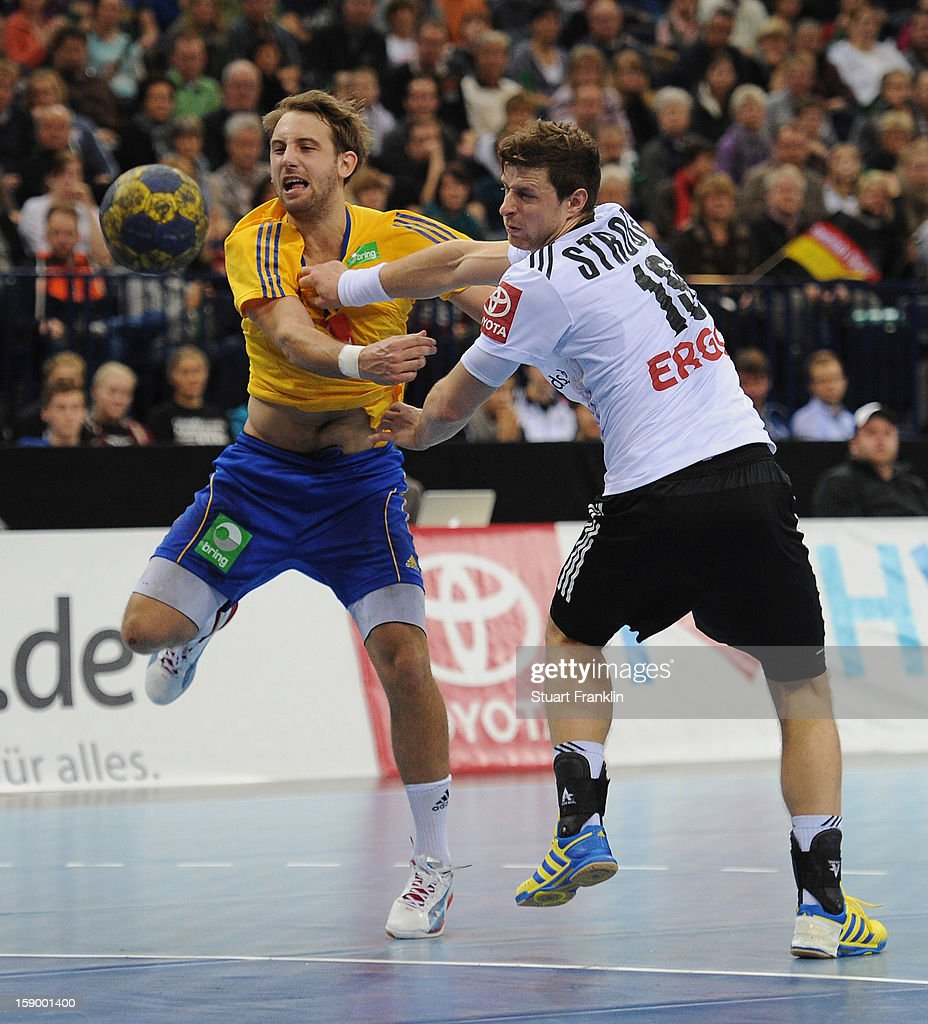 Martin Strobel of Germany challenges for the ball with Patrick Fahlgren of Sweden during the international handball friendly match between Germany and Sweden at O2 World on January 5, 2013 in Hamburg, Germany.