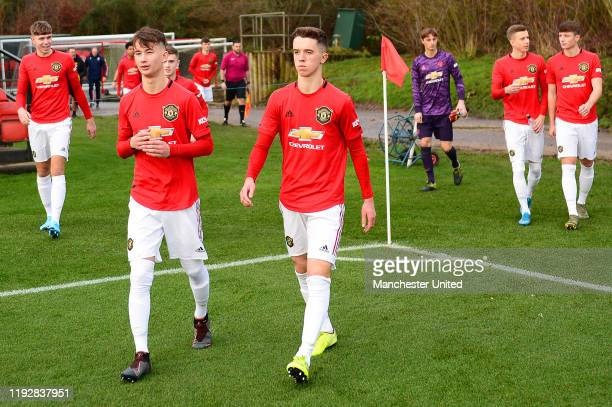 Martin Svidersky and Harvey Neville of Manchester United U18s walk out ahead of the U18 Premier League match between Manchester United U18s and Stoke...