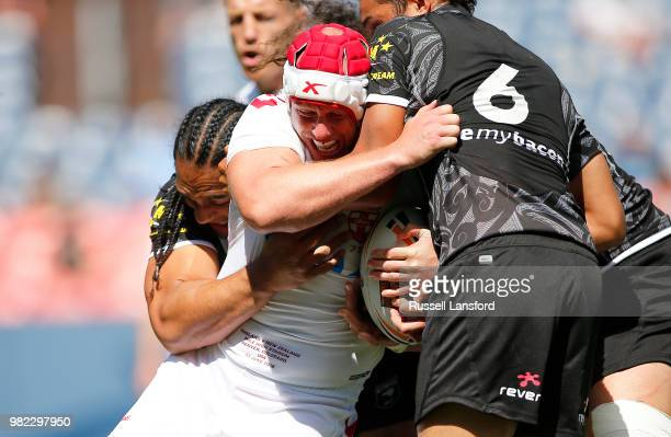 Martin Taupau and Te Maire Martin of New Zealand tackle Chris Hill of England during the second half of a Rugby League Test Match between England and...