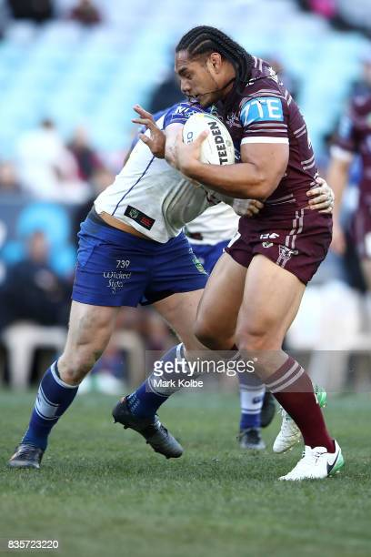 Martin Taupau is tackled during the round 24 NRL match between the Canterbury Bulldogs and the Manly Sea Eagles at ANZ Stadium on August 20 2017 in...