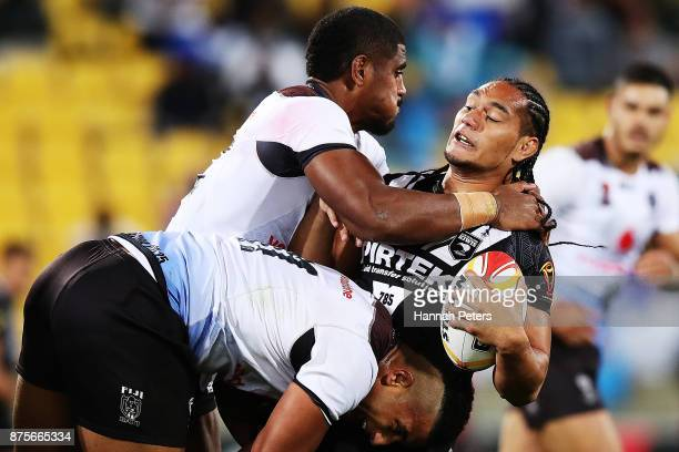 Martin Taupau of the Kiwis charges forward during the 2017 Rugby League World Cup Quarter Final match between New Zealand and Fiji at Westpac Stadium...