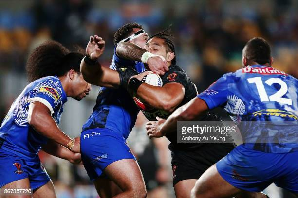 Martin Taupau of the Kiwis is tackled by Jazz Tevaga of Samoa during the 2017 Rugby League World Cup match between the New Zealand Kiwis and Samoa at...