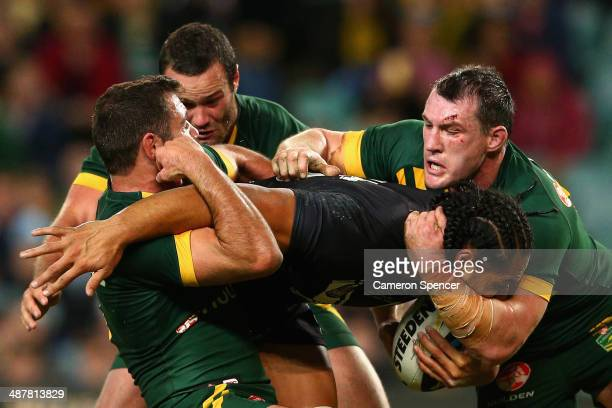 Martin Taupau of the Kiwis is tackled during the ANZAC Test match between the Australian Kangaroos and the New Zealand Kiwis at Allianz Stadium on...