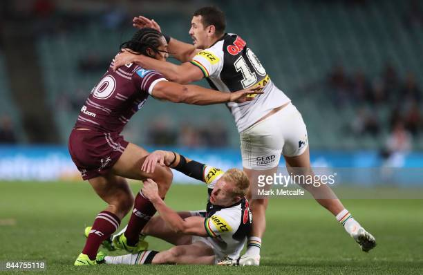 Martin Taupau of the Sea Eagles is tackled by Peter Wallace of the Panthers and Reagan CampbellGillard of the Panthers during the NRL Elimination...