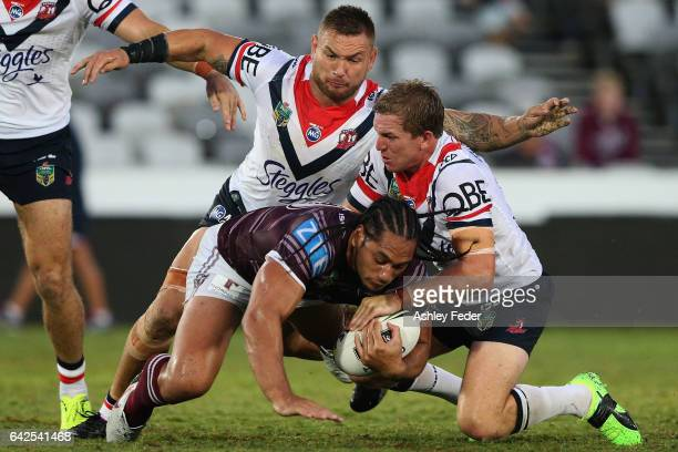 Martin Taupau of the Sea Eagles is tackled by the Roosters defence during the NRL Trial match between the Manly Warringah Sea Eagles and Sydney...