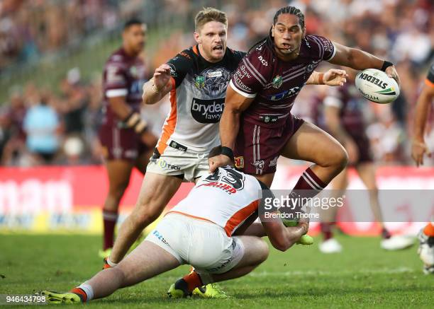 Martin Taupau of the Sea Eagles is tackled by the Tigers defence during the round six NRL match between the Manly Sea Eagles and the Wests Tigers at...