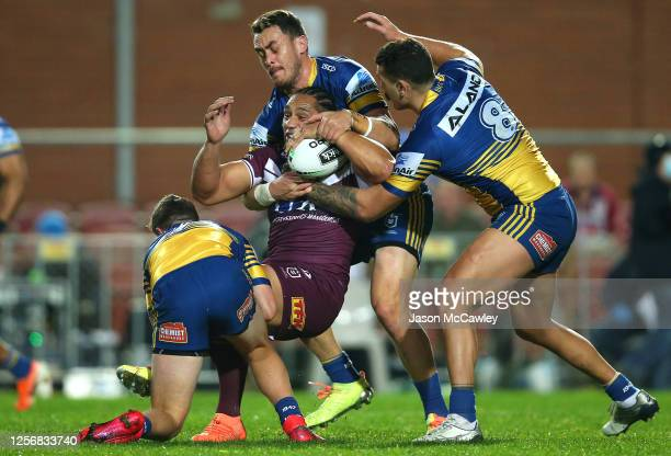 Martin Taupau of the Sea Eagles is tackled during the round 10 NRL match between the Manly Sea Eagles and the Parramatta Eels at Lottoland on July...
