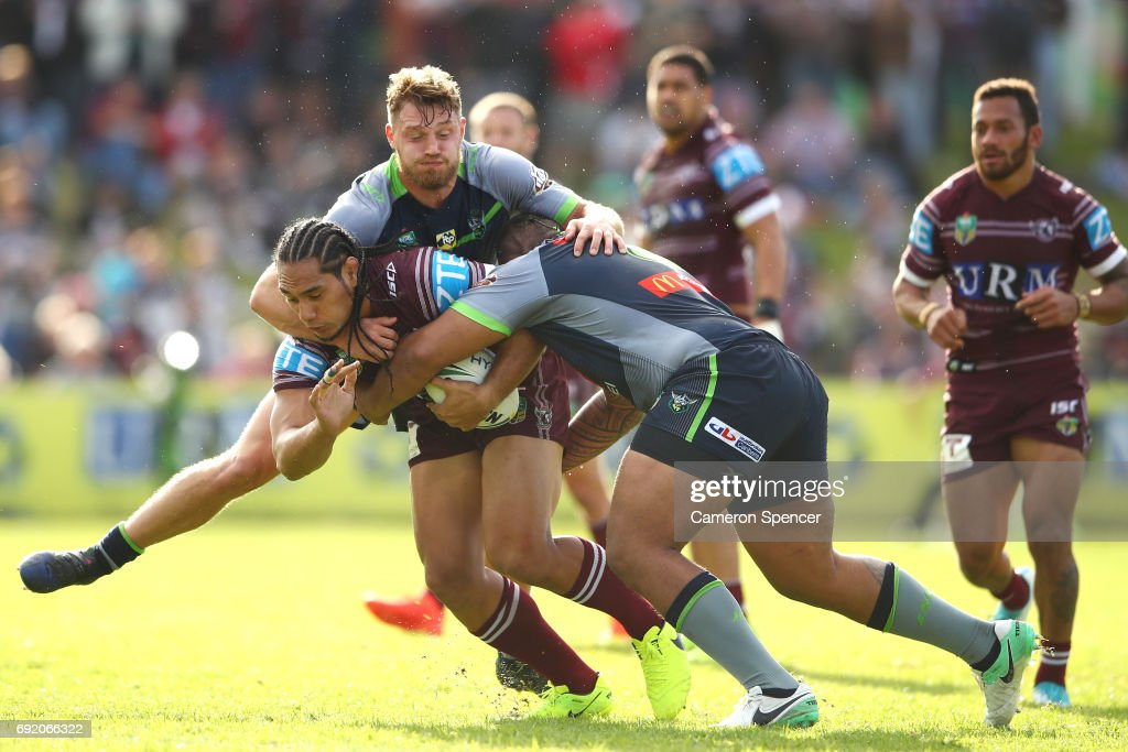 Martin Taupau of the Sea Eagles is tackled during the round 13 NRL match between the Manly Sea Eagles and the Canberra Raiders at Lottoland on June 4, 2017 in Sydney, Australia.
