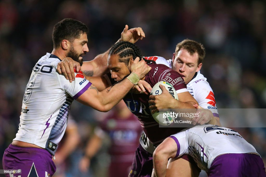 Martin Taupau of the Sea Eagles is tackled during the round 18 NRL match between the Manly Sea Eagles and the Melbourne Storm at Lottoland on July 14, 2018 in Sydney, Australia.