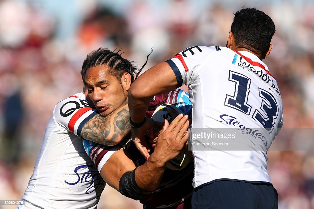 Martin Taupau of the Sea Eagles is tackled during the round 22 NRL match between the Manly Warringah Sea Eagles and the Sydney Roosters at Lottoland on August 6, 2017 in Sydney, Australia.