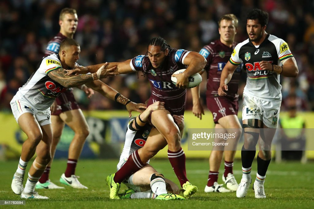 Martin Taupau of the Sea Eagles is tackled during the round 26 NRL match between the Manly Sea Eagles and the Penrith Panthers at Lottoland on September 2, 2017 in Sydney, Australia.