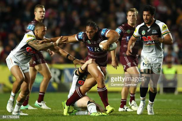 Martin Taupau of the Sea Eagles is tackled during the round 26 NRL match between the Manly Sea Eagles and the Penrith Panthers at Lottoland on...