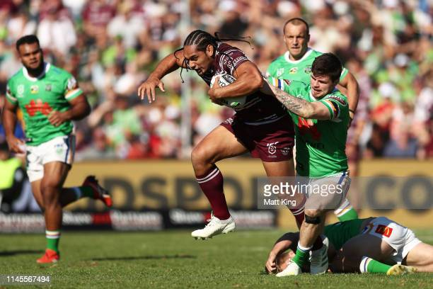 Martin Taupau of the Sea Eagles is tackled during the round 7 NRL match between the Manly Warringah Sea Eagles and the Canberra Raiders at Lottoland...