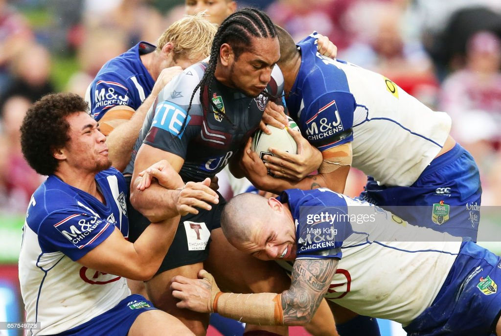 Martin Taupau of the Sea Eagles is tackled during the round four NRL match between the Manly Warringah Sea Eagles and the Canterbury Bulldogs at Lottoland on March 25, 2017 in Sydney, Australia.
