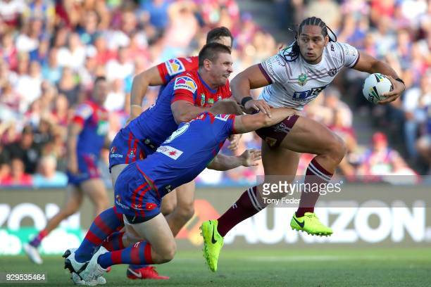 Martin Taupau of the Sea Eagles is tackled during the round one NRL match between the Newcastle Knights and the Manly Sea Eagles at McDonald Jones...