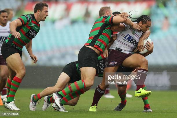 Martin Taupau of the Sea Eagles is tackled during the round three NRL match between the South Sydney Rabbitohs and the Manly Sea Eagles at ANZ...