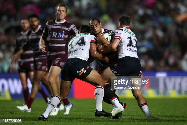 Martin Taupau of the Sea Eagles is tackled during the round two NRL match between the Manly Sea Eagles and the Sydney Roosters at Lottoland on March...