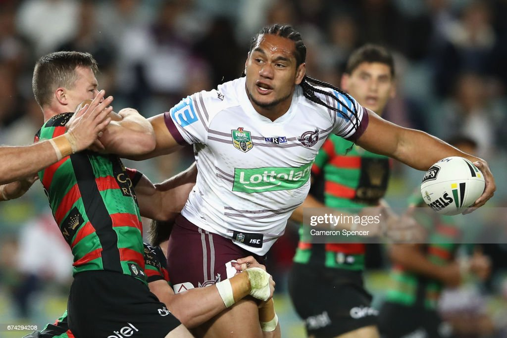 Martin Taupau of the Sea Eagles passes the ball whilst being tackled during the round nine NRL match between the South Sydney Rabbitohs and the Manly Sea Eagles at Allianz Stadium on April 28, 2017 in Sydney, Australia.