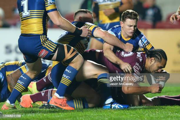 Martin Taupau of the Sea Eagles scores a try during the round 10 NRL match between the Manly Sea Eagles and the Parramatta Eels at Lottoland on July...
