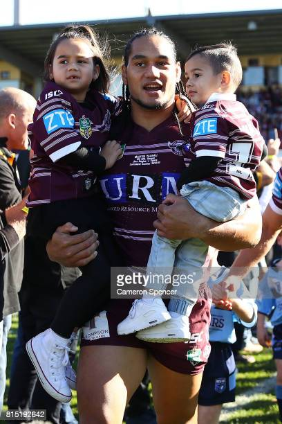 Martin Taupau of the Sea Eagles walks onto the field with his children before playing in his 100th first grade game during the round 19 NRL match...