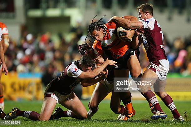 Martin Taupau of the Tigers is tackled by the Sea Eagles defence during the round 18 NRL match between the ManlyWarringah Sea Eagles and the Wests...