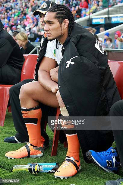 Martin Taupau of the Tigers watches on from the sideline during the round 13 NRL match between the Newcastle Knights and the Wests Tigers at Hunter...