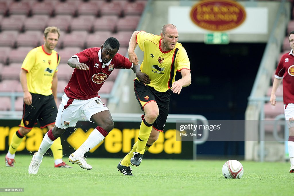 Martin Taylor of Watford moves away from the challenge of Courtney Herbert of Northampton Town during the pre season match between Northampton Town and Watford at Sixfields Stadium on July 24, 2010 in Northampton, England.