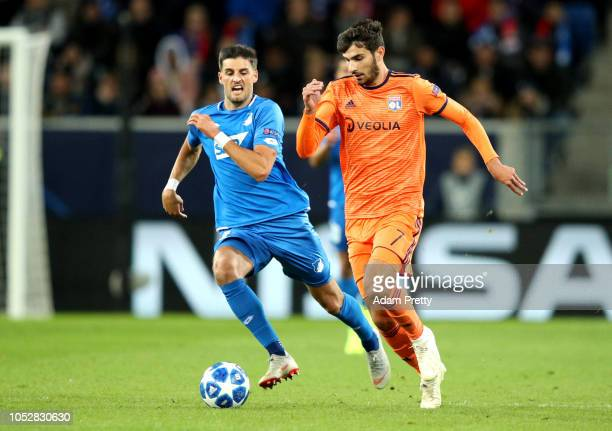Martin Terrier of Olympique Lyonnais breaks away from Florian Grillitsch of 1899 Hoffenheim during the Group F match of the UEFA Champions League...