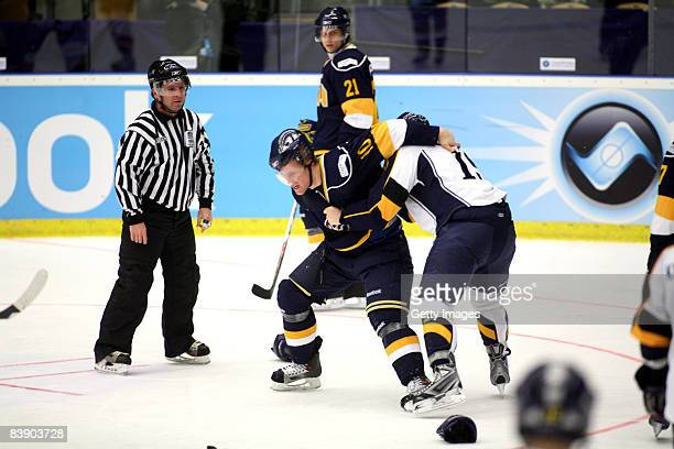 Martin Thrnberg fights with Patrik Lostedt during the IIHF Champions Hockey League match between HV 71 Joenkoeping and Espoo Blues on December 3,...