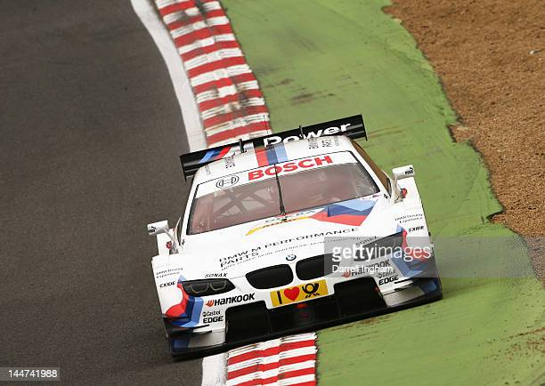 Martin Tomczyk of Germany drives the BMW Team RMG BMW M3 DTM during practice for the DTM German Touring Car Championship race at the Brands Hatch...